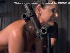 Slut is whipped in doggy device bdsm
