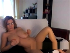 Undreesing and show us her huge natural tits on webcam