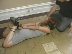 Nice redhead gets hogtied and left on the floor