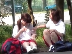 Japanese lesbian babes kiss and lick each other