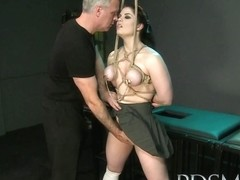 Black haired sub has breasts tied to the ceiling by her Master before anal hook play