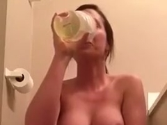 Sexy amateur brunette pissing in cup then drinking it