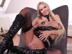 Florane Russell is a smoking hot blonde in black, latex costume who likes to play with dildos