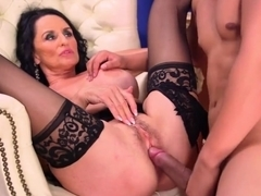 Mature woman with dark hair and big tits is having wild sex with her lover