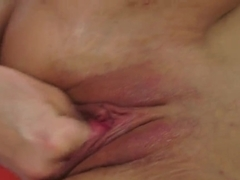 Angel Piaf spreads her oiled up pussy, wide