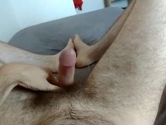 Horny and young hairy guy leaks precum as he moans and talks