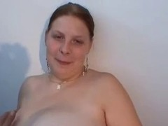 bulky gal with large scoops in masturbating act