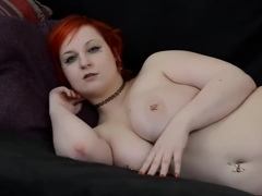 Emo chick with huge pierced boobs strips on sofa