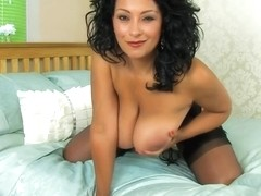 Curvaceous, dark haired milf, Danica Collins is wearing black stockings while showing her wet pussy