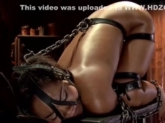 Stunning chained ebony gets whipped