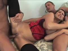 A lingerie-clad MILF works two dicks at once
