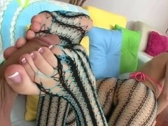 Nice scene with beautiful footjob and foot fetish games
