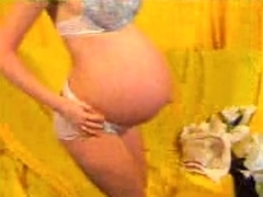 Fondling my pregnant tummy on webcam