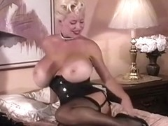 HUGE BOOBS IN BLACK NYLONS STRIPS