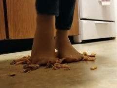 Cheeseburger and fries crushed under nylon feet, walkover style