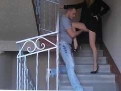 Classy girl ball busting a guy on the stairs