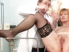 Redhead granny immodest muff stretching in gyn clinic