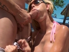Blonde with fake tits Jessie Rogers takes dick up the ass in the sun
