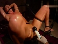 Oiled Wenona teased until she pisses and cums