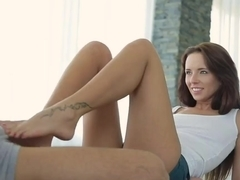Leggy Gina Devine is performing hot footjob