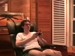 Nerdy guy plays videogames, while his hot gf rides his cock.