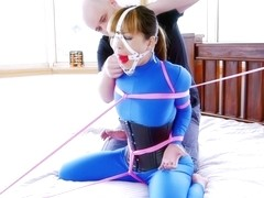 Asian Babe In A Blue Catsuit Is About To Experience Bondage The Way She Was Dreaming About
