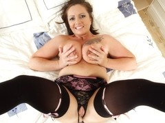 Sexy Sam from the UK plays with her shaven pussy
