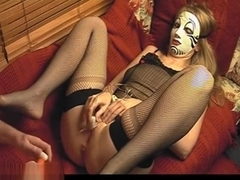 Masked Babe Using A Vibrator