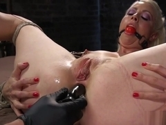 Hogtied blonde butt plugged in dungeon