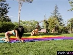 Two teen lesbian babes kissing and licking in the backyard
