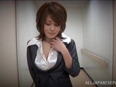 Hot Asian milf in an office suit gives tit fuck