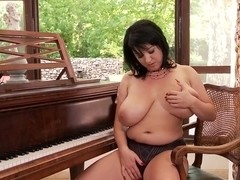 Big brunette woman is demonstrating body