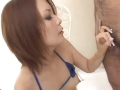 Skinny Japanese whore gets a load on her tits