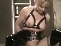 Vintage blond in boots screwed on ladder