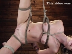 Blonde slave in suspension is whipped