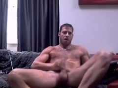 Seductive man is playing at home and filming himself on web camera