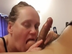 Mature gal on her knees licking a dick