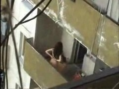 Voyeur couple fucks on the balcony