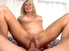 Busty blonde cougar, Erica is sucking dick to make it hard, before she starts riding it