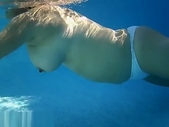 A Big Ass Slut Swims Topless
