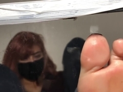 Toes Pressed on Glass
