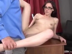 Skinny brunette with glasses is kneeling on the floor and waiting for her deserved facial cumshot