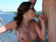 A hot girl sucks dick on some rich man's boat