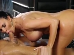 Jasmine Jae Uses Her Tits To Stroke His Cock On The Table