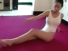 Flexible Asian ballerina stretches out