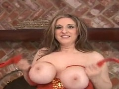 Mature woman Kitty Lee showing her huge breasts and horny pussy