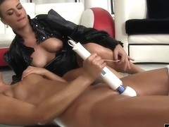 Two girls play with a vibrator