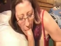 Milf in glasses sucks my cock