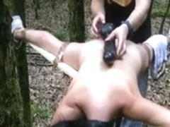 Bound to a cross and screwed with a large vibrator in the forest